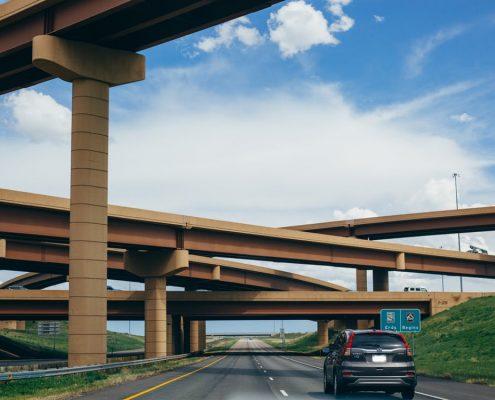 car driving under bridges