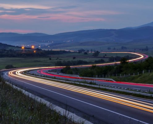 time lapse highway at dusk